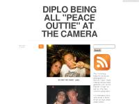 DIPLO BEING ALL PEACE OUTTIE AT THE CAMERA